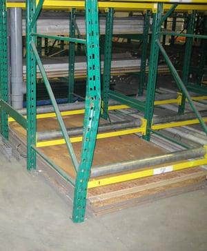 Damaged pallet rack upright