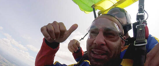 Damotech employee parachute jump