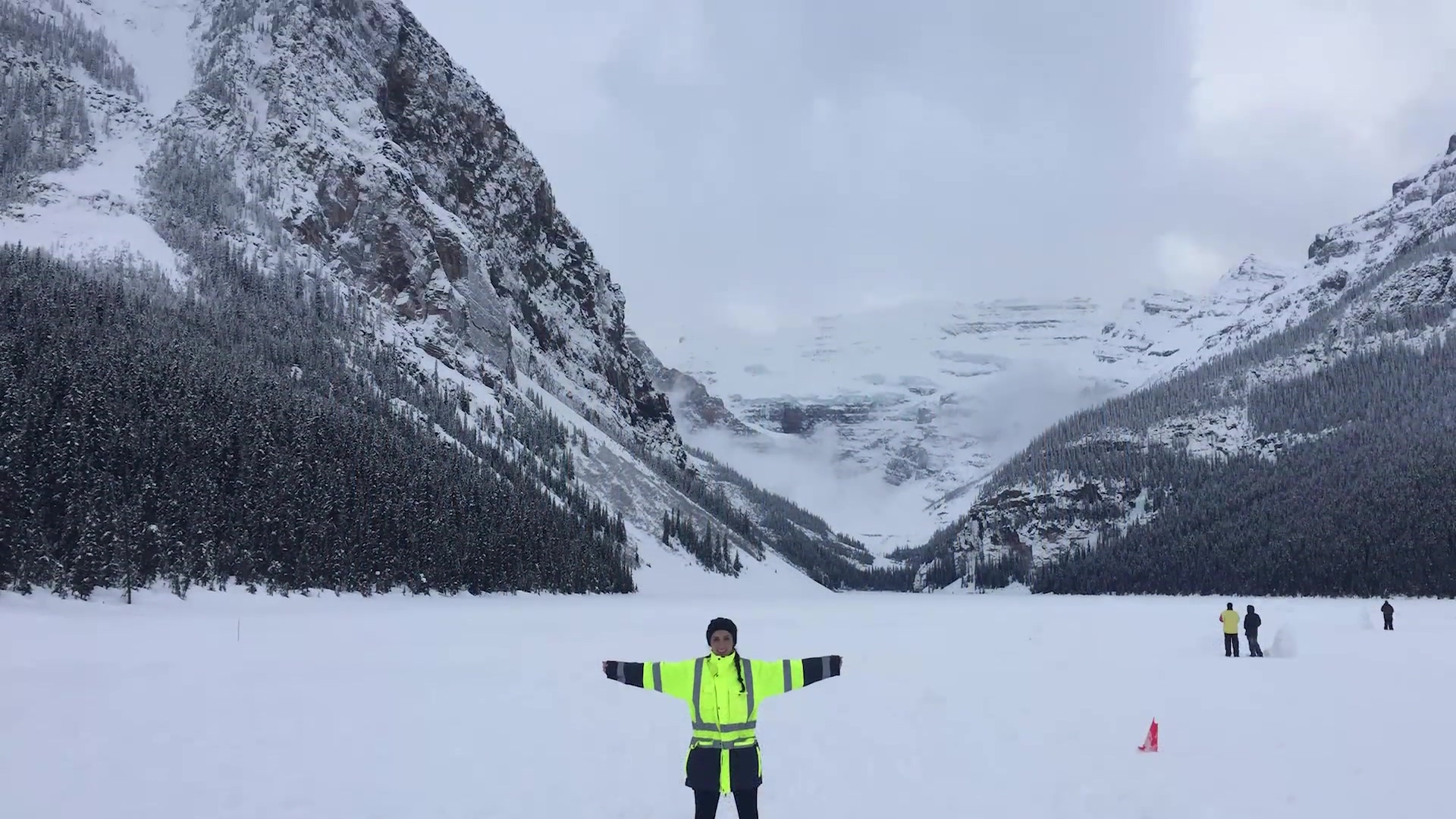 Damotech female engineer in front of mountains and snow