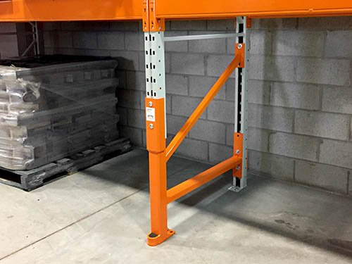 An orange Damo Pro repair kit installed on a pallet rack system