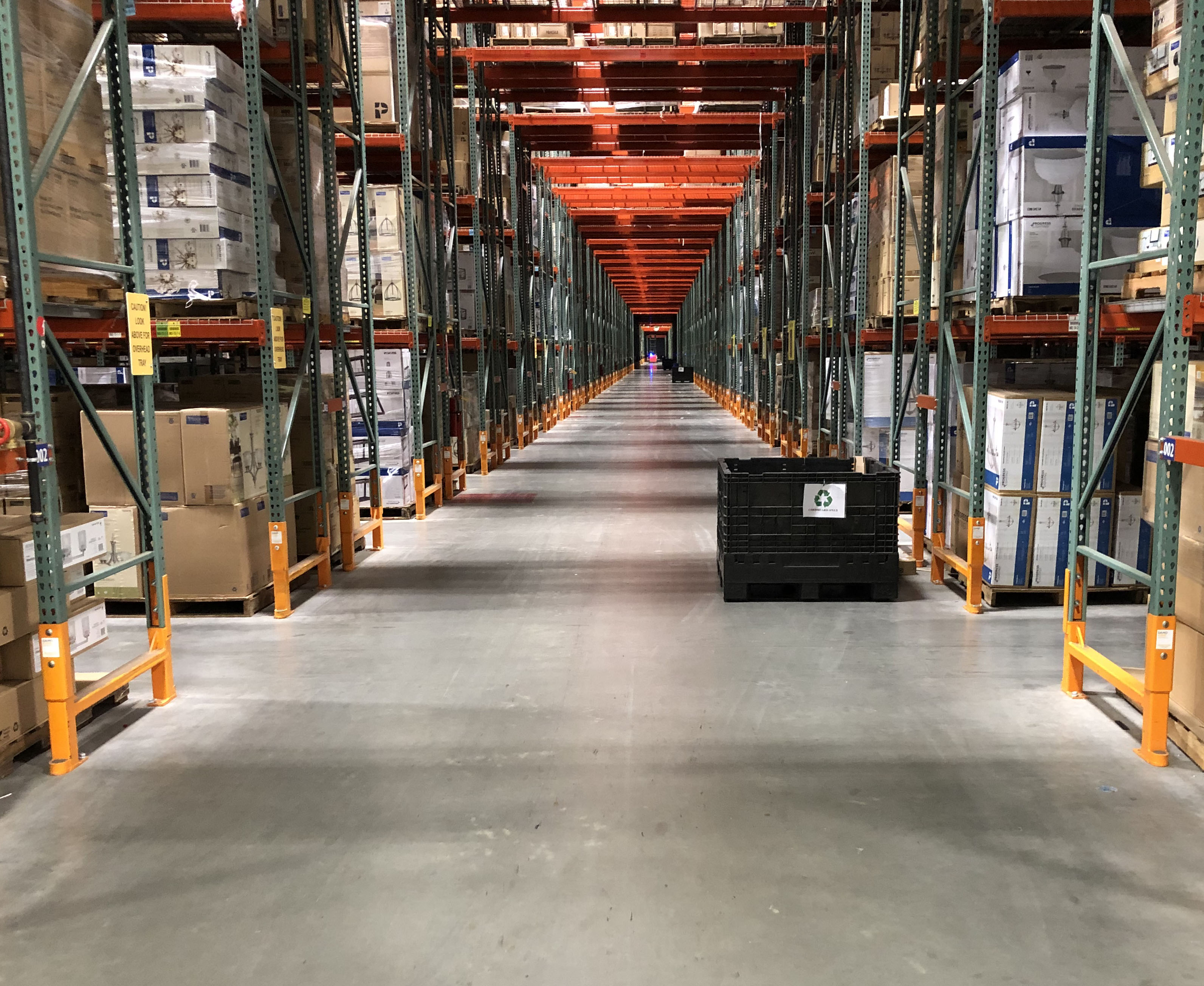 Warehouse aisle uprights protected by Damotech Damo King